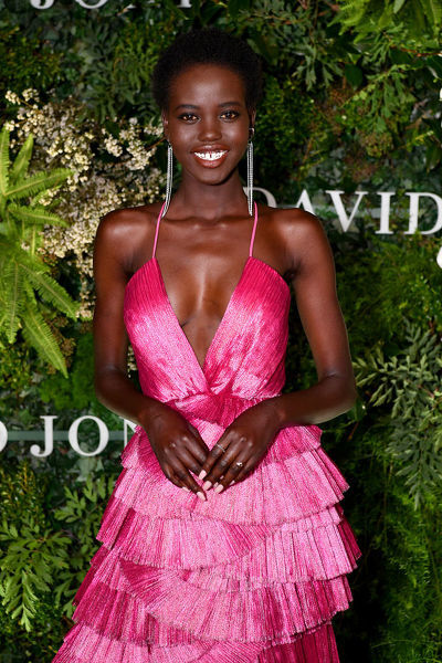Australian model Adut Akech arrives at the David Jones Spring Summer 2018 Collections Launch, in Sydney, Wednesday, August 8, 2018. (AAP Image/Joel Carrett)