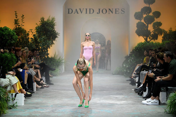 A model adjusts her shoe as she walks the runway during the David Jones Spring Summer 2018 Collections Launch, in Sydney, Wednesday, August 8, 2018. (AAP Image/Dan Himbrechts)