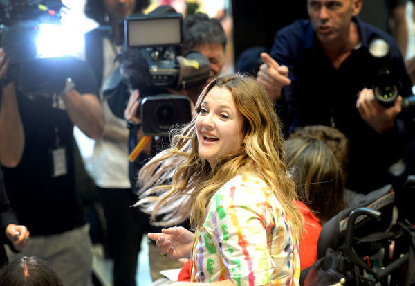Actress Drew Barrymore is seen during the launch of her cosmetic range FLOWER Beauty at Westfield Parramatta in Sydney, Saturday, April 13, 2019. (AAP Image/Jeremy Piper)