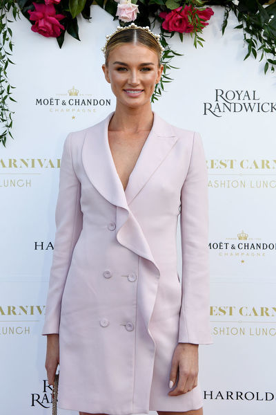 Australian model and athlete Amy Pejkovic poses for a photograph during the inaugural Everest Carnival Fashion Lunch at Royal Randwick Racecourse in Sydney, Thursday, October 10, 2019. (AAP Image/Bianca De Marchi)