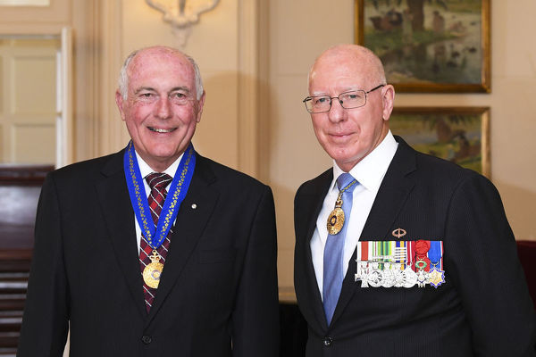 Australian Governor-General David Hurley (right) and former Australian Deputy Prime Minister Warren Truss poses for photographs after he was appointed a Companion in the General Division for eminent service to the Parliament of Australia