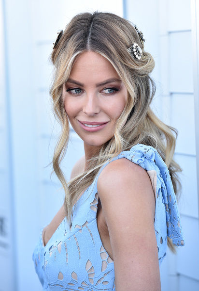 Jennifer Hawkins poses for photos outside the Myer marquee on Oaks Day in Melbourne