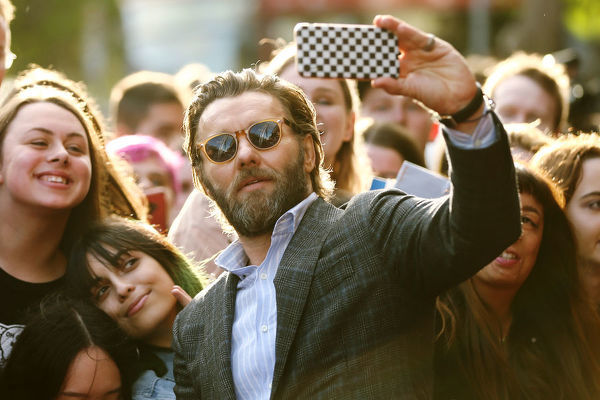 Joel Edgerton takes a selfie with fans at the Australian premiere of The King at The Ritz Cinema, Randwick, Sydney, Thursday, October 10, 2019. (AAP Image/Brendon Thorne)