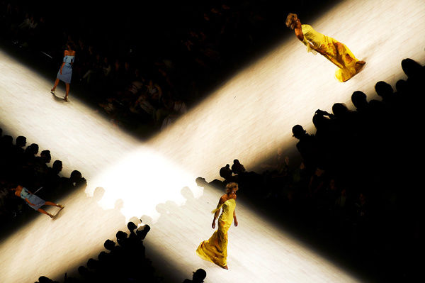 In a multiple exposure image, a model wears a design by De La Motte during the Raffles International Showcase show, at Mercedes-Benz Fashion Week Australia in Sydney