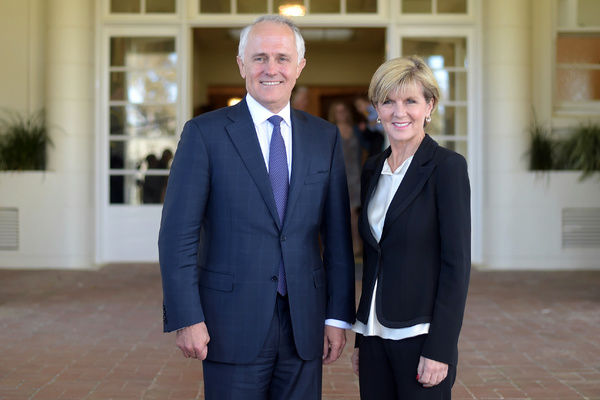 Australian Prime Minister Malcolm Turnbull and deputy leader of the LNP Julie Bishop pose for photographs after a swearing-in ceremony at Government House in Canberra