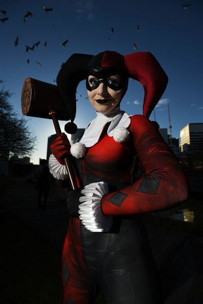 A cosplayer poses for a photograph at the Oz Comic-Con festival, Melbourne, Saturday, June 8, 2019. Australia's largest pop culture gathering, Oz Comic-Con, takes place in Melbourne on the 8th and 9th of June, at the Melbourne Convention and Exhibition Centre