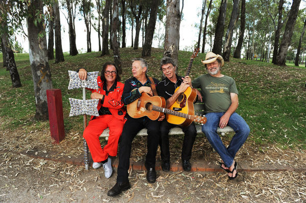 **FILE** A January 17, 2011 file photo of Australian musicians (left to right) Dobe Newton, Tommy Emmanuel, Phil Emmanuel, and Bill Chambers pose for photographs at Bicentennial Park during the Tamworth Country Music Festival in Tamworth