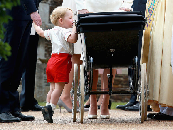 Prince George looks at his sister Princess Charlotte as they leave the Church of St Mary Magdalene in Sandringham, Norfolk