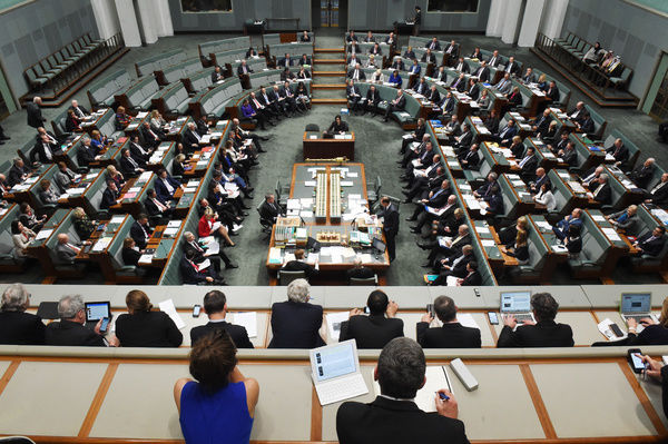 Journalists in the Press Gallery listen to Australian Prime Minister Tony Abbott speak at Parliament House in Canberra
