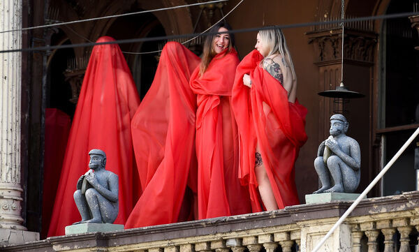 Subjects pose for contemporary New York artist Spencer Tunick, who is photographing nude Melburnians for his latest piece, 'Return of the Nude', as part of Chapel st, Prahran's Provocare festival, in Melbourne, Monday, July 9, 2018
