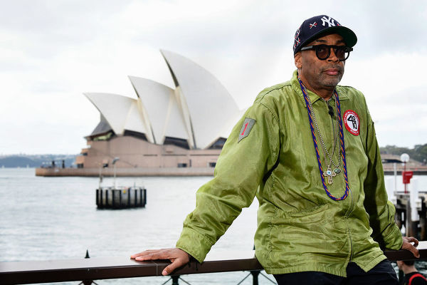 American film director Spike Lee poses for a photograph in front of the Sydney Opera House during a media call at the Park Hyatt in Sydney, Saturday, June 1, 2019. Spike Lee is a guest speaker at the Vivid Ideas Game Changer event