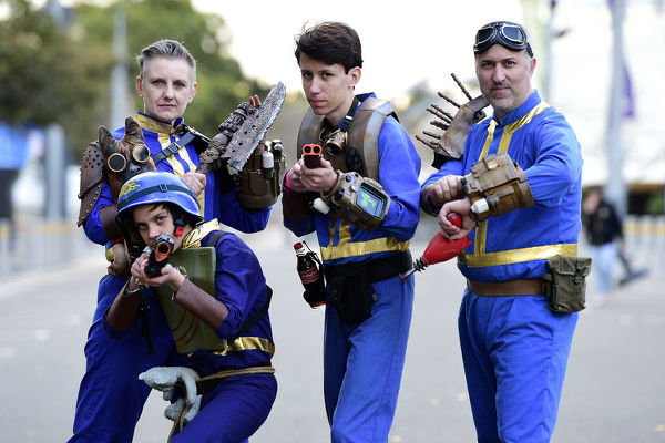 Fiona Broadway-Bennett (left), Finn Broadway-Bennett (left centre), Cooper Broadway-Bennett (centre right) and Corey Broadway-Bennett (right), all dressed in cosplay as vault dwellers from Fallout 4, pose for a photograph at Sydney Supanova 2019 conference