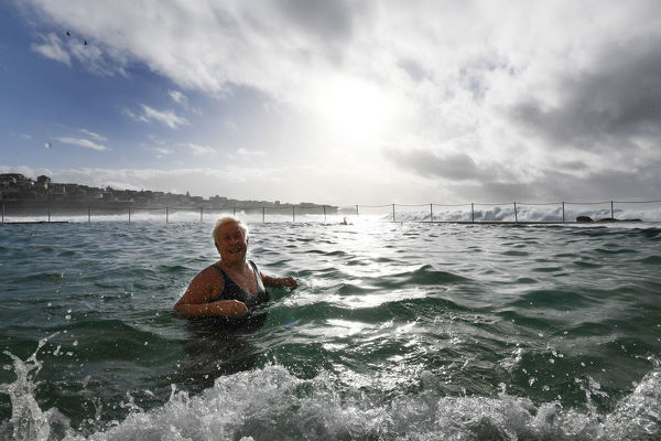 Bronte local Margaret Horscroft takes to the water at Bronte Baths on the first day of winter, Sydney, Friday, June 1, 2018. Temperatures plummeted literally overnight following a very mild autumn. (AAP Image/Dean Lewins)