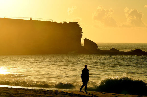 The sun rises in Coogee, Sydney, Thursday, July 12, 2018. (AAP Image/Joel Carrett)