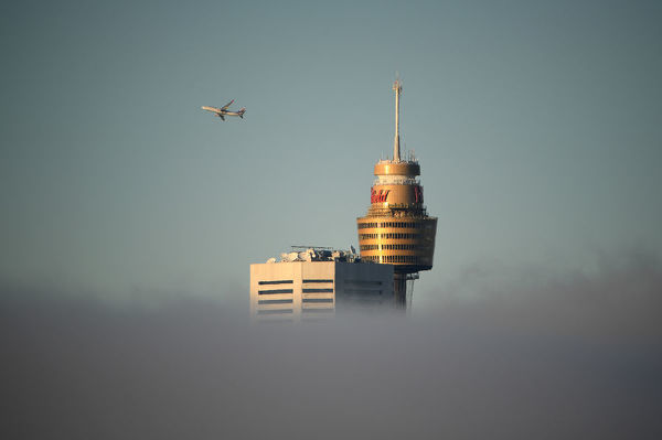 Heavy fog is seen blanketing the Sydney skyline on, Thursday, July 5, 2018. Heavy fog has delayed flights from Sydney airport and ferry services on the harbour. (AAP Image/Dan Himbrechts)