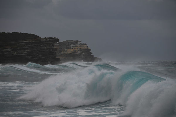 Winter weather and large surf lashes Bronte Beach, on Tuesday, June 19, 2018