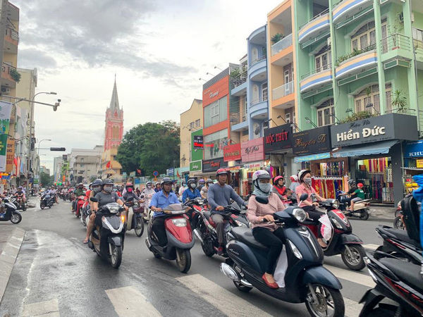 Motorbikes are seen in Ho Chi Minh City, Vietnam, Wednesday, June 5, 2019. Ho Chi Minh City, like many towns and cities in Vietnam, are awash with motorbikes. HCMC is a forward-looking city burgeoning with creativity. (AAP Image/Caroline Berdon)